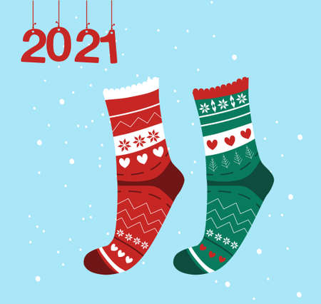 Winter collection of knitted socks, warm woolen Scandinavian elven knee-highs. Happy New Year 2021 and Christmas card.The numbers hang on ribbons,snowflakes around.Children's accessory, promo sale 免版税图像 - 154346595