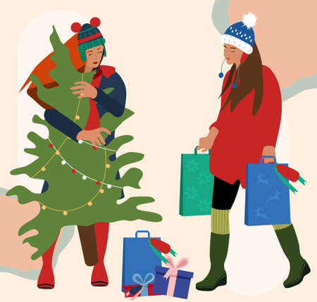 Two girls in warm winter clothes making holiday shopping.Woman carrying Christmas tree from street market in hands.Gift boxes with bow lie around.Female holding packets with presents.Stylish garment