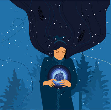Cute young woman holds magic ball with fairy european house inside it.Night landscape with winter forest, Christmas trees silhouettes and snowflakes.New year postcard.Girl with long hair makes a wish