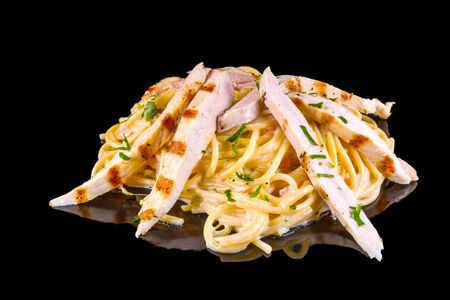 """Delicious spaghetti named """"Amore Mio"""" with grilled chicken with reflection, isolated on black background"""