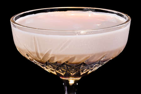 Orgasm cocktail in a glass, art view, isolated on black background Stock Photo