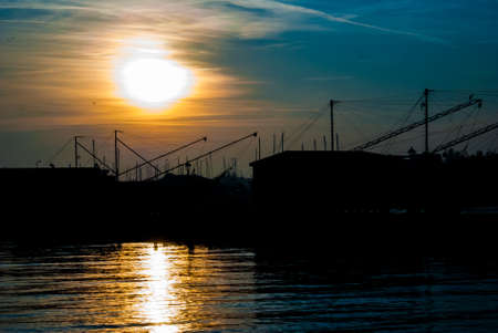 Adriatic sea coast at sunset with an ancient fishing hut trabucco Stock fotó