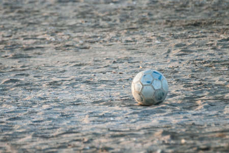 Cesenatico, November 1 2014: Abandoned ball in the sand