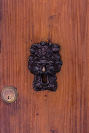 Old lock in a wooden door in Bologna, Emilia-Romagna