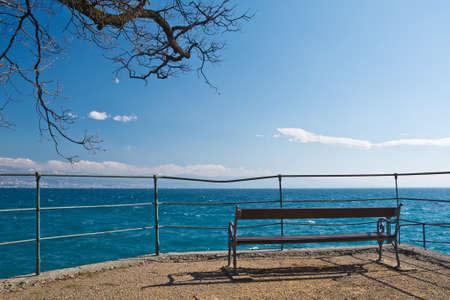 KA: Lovran Croatia, benches on the shore of Lovran Stock Photo