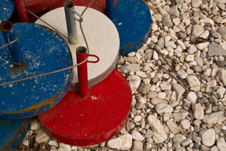 ponderous: sunshade bases, base for umbrellas arranged on the beach