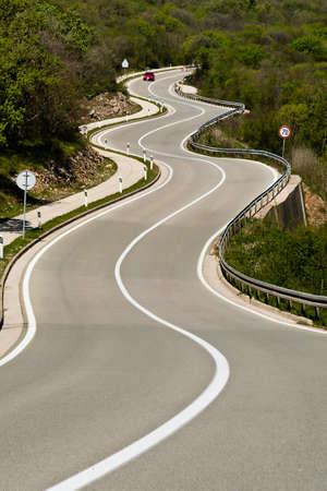 tortuous: tortuous road full of bends in the mountain meadows