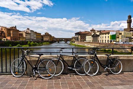 river arno: three bikes photographed on the bridge over the River Arno , Florence , Italy Stock Photo