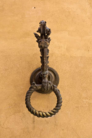 hitching post: antique hitching post on stone wall, Siena , Tuscany, Italy