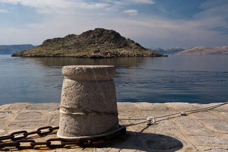 small island and stone bollard