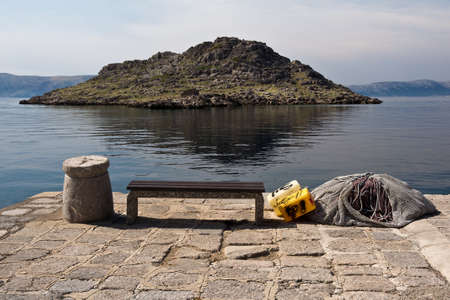 bollard: small island and stone bollard