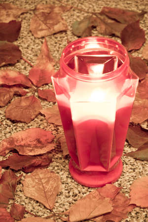 all saints day: Grave with light candles at All Saints Day Stock Photo