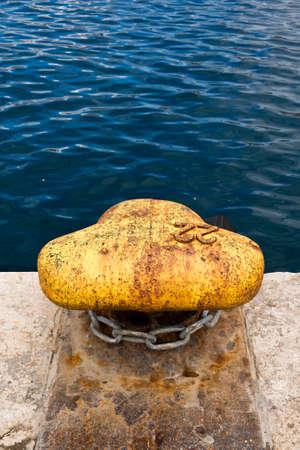 bollard: yellow bollard and chain Stock Photo