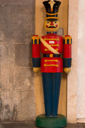 christmas toy: wooden Nutcracker Statues photographed in the streets of Bologna , Italy