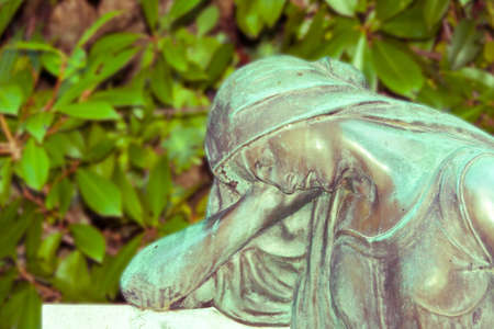 saturation: Statue of a sad woman , vintage saturation Stock Photo