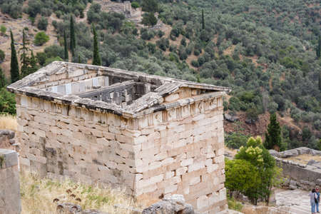 The Treasury of the Athenians on the Hillside of the Archaeological Site of Delphi, Greece Stok Fotoğraf