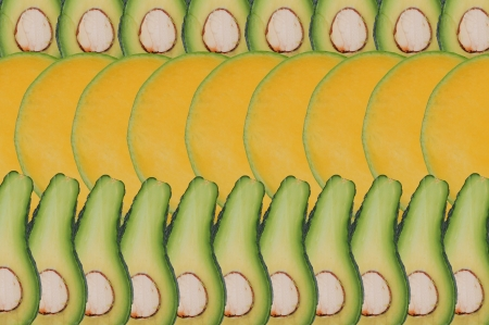Composition made of slices of mango and avocado photo