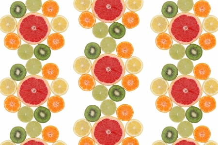 Flower composition made of slices of tropical fruits photo