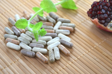 herbal capsules with mint leaves photo