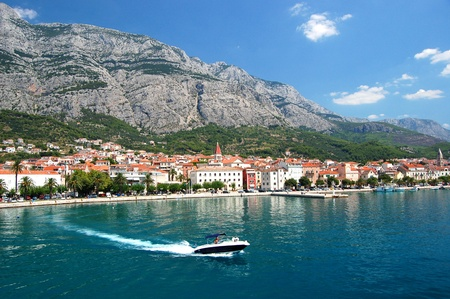 dashing motorboat on makarska riviera, croatia