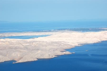 majestic picturesque severe bare stone island of Pag in Croatia photo