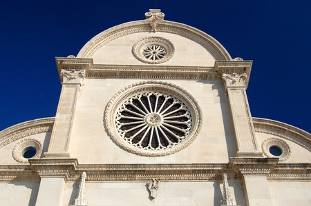heads old building facade: St  James Cathedral in Sibenik, Croatia