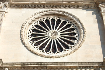 heads old building facade: Rosette of St  James Cathedral in Sibenik, Croatia Stock Photo