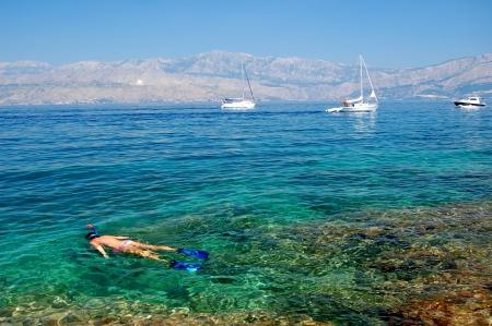 Young girl snorkelling in adriatic sea on Brac island, Croatia