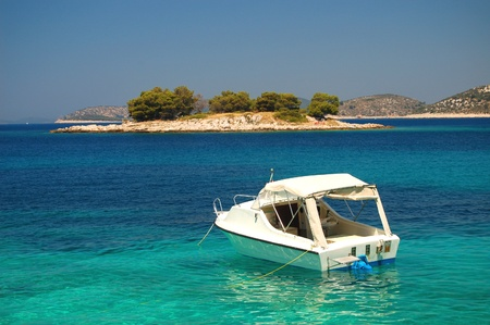 Picturesque scenic view of boat on adriatic waters, Croatia