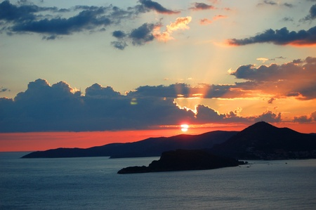 Spectacular moody scenic sunset over Budva, Montenegro photo