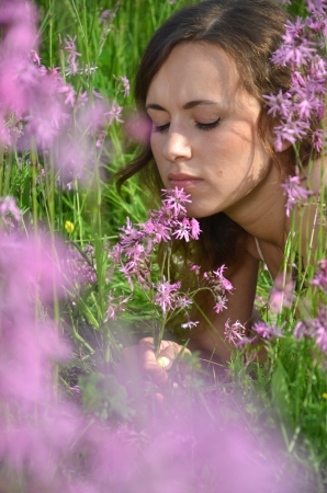 superb: beautiful attractive young girl on gorgeous meadow full of wild flowers