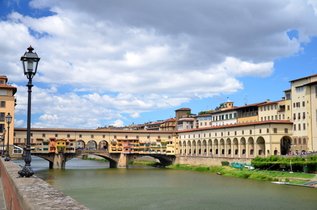 Ponte Vecchio over Arno River in Florence, Italy photo
