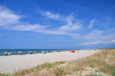 Picturesque view on Italian sandy beach Marina di Vecchiano nearby Pisa, Tuscany – Italy  免版税图像
