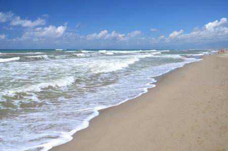 restless: Restless sea on sandy beach Marina di Vecchiano nearby Pisa, Tuscany in Italy  Stock Photo