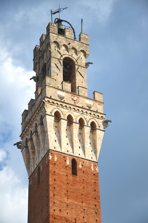 The tower of Palazzo Pubblico on Piazza del Campo in Siena, Tuscany, Italy photo