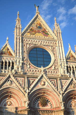 ade: Façade of magnificent marble cathedral in Siena, Italy