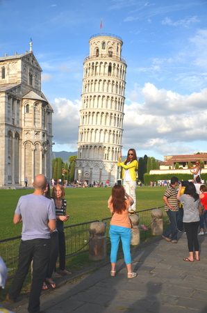 Tourists on Piazza di Miracoli in Pisa, Italy