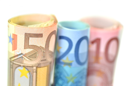 rolls of euro banknotes isolated on white Stock Photo