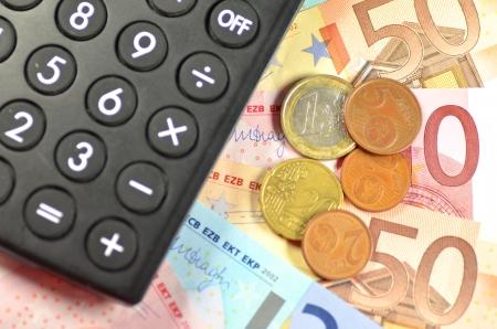 euro banknotes, coins and calculator photo