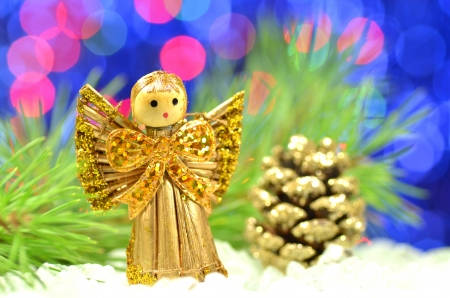 christmas decoration, angel made of straw and bokeh background photo