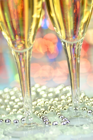 two glasses of champagne against bokeh  Stock Photo