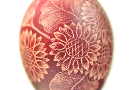Traditional scratched handmade Easter egg on white background photo