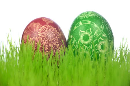 Two traditional scratched handmade Easter eggs in the grass photo