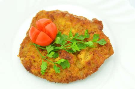 breaded pork chop: breaded pork chop on a plate