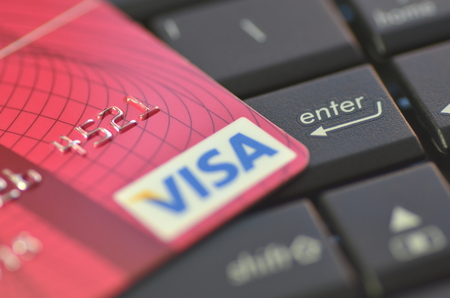 Closeup of VISA credit card on laptop keyboard Stock Photo - 28165371