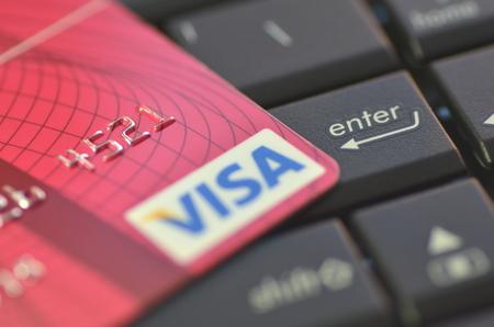 Closeup of VISA credit card on laptop keyboard Stock Photo - 28165371