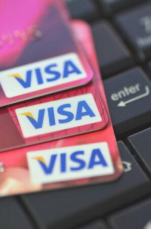 Closeup of VISA credit card on laptop keyboard