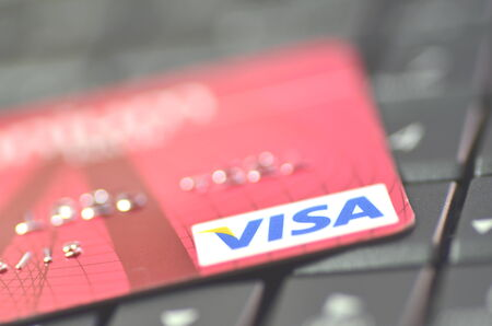 Closeup of VISA credit card on laptop keyboard