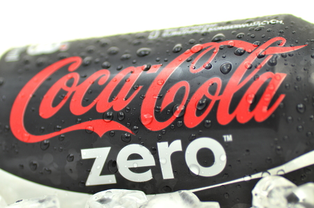 Can of Coca-Cola Zero drink on ice Editorial