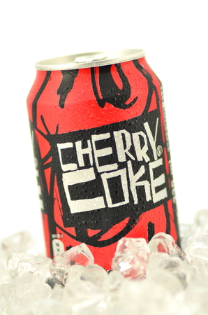 Can of Cherry Coke drink isolated on ice